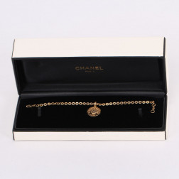 "bracelet and charm ""1932"" gold and diamonds"